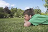 Boy  lying on elbows — Stock Photo