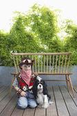Boy and Dog on Veranda — Stock Photo
