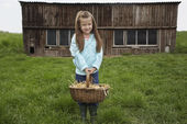 Girl holding egg basket — Stock Photo