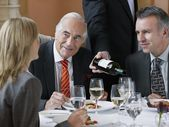 Business people talking at restaurant — Stock Photo