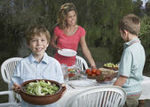 Mother and sons  preparing dinner — Stock Photo