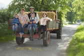 Family on Tractor Trailer — Stock Photo