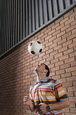 Man heading football — Stock Photo