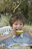 Boy eating melon — Stock Photo