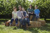 Family sitting in Countryside — Foto Stock