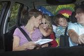 Family  talking in car — Stock Photo