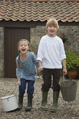 Brother and Sister Holding Pails — Stock Photo