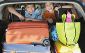Boys in loaded car — Stock Photo