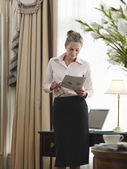 Businesswoman Reading Document — Stock Photo