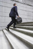 Business man carrying briefcase — Stock Photo