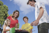 Children grilling in garden — Foto Stock