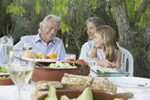 Grandparents sitting at table — Stock Photo