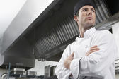 Chef with arms crossed standing — Stock Photo