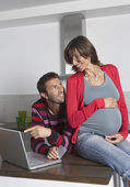 Man and Woman Using Laptop — Stock Photo