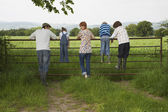 Family Looking on Farmland — Stock Photo