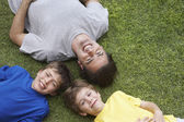 Father and sons lying — Stock Photo