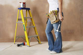 Woman with toolbelt and hummer — Stock Photo