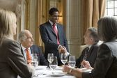 Business people at restaurant — Stock Photo