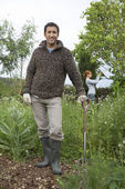 Man with spade standing — Stock Photo