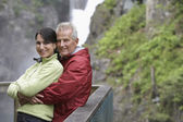 Couple posing by railing — Stock Photo