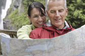 Man and woman reading map — Stock Photo