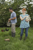 Couple Feeding Chickens — Stock Photo
