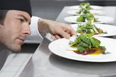 Chef preparing salad — Stock Photo