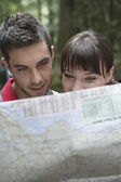 Couple observing map — Stock Photo