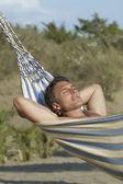 Man Relaxing in Hammock — Stock Photo