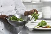 Chef preparing salad in kitchen — Stock Photo
