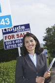 Smiling Real Estate Agent — Stock Photo