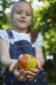 Girl  holding apple — Stock Photo