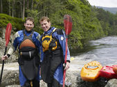 Kayakers Standing at Riverbank — Stock Photo