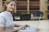Office worker using laptop in legal office — Stockfoto