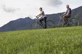 Man and woman biking — Stock Photo