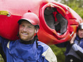 Kayakers Carrying Boat — Stock Photo