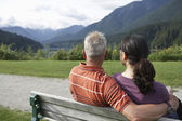 Couple sitting on bench — Stock Photo
