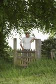 Farmer Standing at Gate — Stock Photo