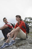 Couple sitting on rocks — Stock Photo