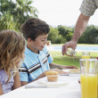 Two children sitting at table — Stock Photo #33880467