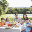 Family with three children  sitting at table — Stock Photo #33880667