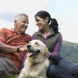 Couple and golden retriever resting — Stock Photo #33881503