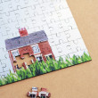 Stock Photo: Jigsaw puzzle with house