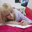 Girl writing diary — Stockfoto #33883913