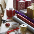 Christmas gifts, wrapping paper and accessories — Stock Photo #33884975