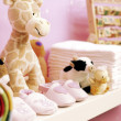 Stuffed toys, shoes and nappies — Stock Photo