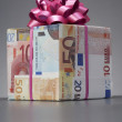 Stock Photo: Small gift wrapped in Euro notes