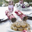 Stock Photo: Christmas crackers and mince pies