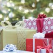 Stock Photo: Christmas presents on floor