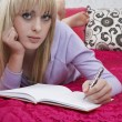 Girl writing diary — Stockfoto #33886883